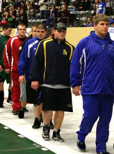 "<div class=""source"">Matt Birkholtz</div><div class=""image-desc"">Cody Miskell walks during the opening ceremony of the KHSAA State Wrestling Championships at Alltech Arena in Lexington.</div><div class=""buy-pic""><a href=""/photo_select/13431"">Buy this photo</a></div>"