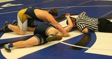 "<div class=""source"">Matt Birkholtz</div><div class=""image-desc"">Cody Miskell pins Bobby Spears of Mooe High School during the first round consolation match.</div><div class=""buy-pic""><a href=""/photo_select/13437"">Buy this photo</a></div>"