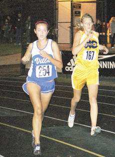"""<div class=""""source"""">Angela Cummins</div><div class=""""image-desc"""">Jackie Roche trails a Villa Madonna runner. Roche finished second for the Lady Braves.</div><div class=""""buy-pic""""><a href=""""http://web2.lcni5.com/cgi-bin/c2newbuyphoto.cgi?pub=195&orig=Jackie%2BRoche.jpg"""" target=""""_new"""">Buy this photo</a></div>"""