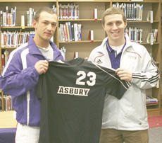"<div class=""source"">Matt Birkholtz</div><div class=""image-desc"">Jaconette holds up an Eagle jersey with coach Zachary Derr.</div><div class=""buy-pic""><a href=""/photo_select/9737"">Buy this photo</a></div>"