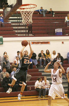 "<div class=""source"">Matt Birkholtz</div><div class=""image-desc"">Demons guard Jake McKinley hits a leaning jump shot against Eminence in the 8th Region All ""A"" Classic.</div><div class=""buy-pic""><a href=""/photo_select/8915"">Buy this photo</a></div>"