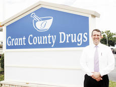 """<div class=""""source""""></div><div class=""""image-desc"""">Jason Wallace, owner of Grant County Drugs, earned the Excellence in Business award.</div><div class=""""buy-pic""""><a href=""""/photo_select/4639"""">Buy this photo</a></div>"""