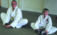 "<div class=""source"">Paige Taylor</div><div class=""image-desc"">James Ramsey and Jemison Beavers warm p and stretch together before their class begins at Grant County Martial Arts.</div><div class=""buy-pic""><a href=""http://web2.lcni5.com/cgi-bin/c2newbuyphoto.cgi?pub=195&orig=Jemison%2BBeavers%252C%2BJames%2BRamsey_0.jpg"" target=""_new"">Buy this photo</a></div>"