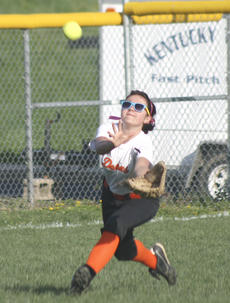 """<div class=""""source"""">Matt Birkholtz</div><div class=""""image-desc"""">Lady Demons left fielder Kaitlyn Kinman attempts to make the catch against Grant County, March 27, at Grant County High School.</div><div class=""""buy-pic""""><a href=""""/photo_select/13858"""">Buy this photo</a></div>"""