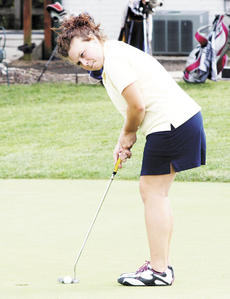 "<div class=""source"">Ryan Naus</div><div class=""image-desc"">Katie Harrison works on the putting green before a match.</div><div class=""buy-pic""><a href=""/photo_select/2297"">Buy this photo</a></div>"