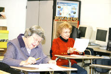 "<div class=""source"">Linda Lawrence</div><div class=""image-desc"">Dorothy Kennedy and her friend Sue Webster concentrate on their final technology exam.</div><div class=""buy-pic""><a href=""http://web2.lcni5.com/cgi-bin/c2newbuyphoto.cgi?pub=195&orig=Kennedy%2Bat%2Bdesk.jpg"" target=""_new"">Buy this photo</a></div>"