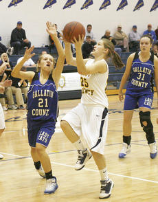 "<div class=""source"">Matt Birkholtz</div><div class=""image-desc"">Eighth grade guard Hannah Kitchens goes up for a lay up against Gallatin County Jan. 6. </div><div class=""buy-pic""></div>"