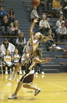 "<div class=""source"">Matt Birkholtz</div><div class=""image-desc"">Tiana Thornberry goes up for the shot over an Ockerman defender Jan. 6.</div><div class=""buy-pic""><a href=""/photo_select/8827"">Buy this photo</a></div>"