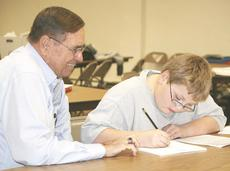 "<div class=""source""></div><div class=""image-desc"">Retired principal Monty Lovell coaches as Michael Brown, a sixth grader at Grant County Middle School, works on math problems.</div><div class=""buy-pic""><a href=""/photo_select/8877"">Buy this photo</a></div>"