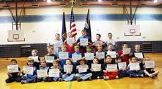 """<div class=""""source"""">Camille McClanahan</div><div class=""""image-desc"""">Graduating class - back row, Logan Clagg, Colt Grout, Braden Jones, Cody Bickers and Caleb Howenstein; middle row, Colten Cruey, Anthony Lewis, Ethan Mosley, Nick Adkins, Hunter Williams, Logan Sutherland, Joseph Franks, Jackson Stiles and Kyle Peck; front row, Kameron Price, Sam Curd, Matt Falon, Coy Goldsberry, Lucky Coleman, Bob Lewis, Justin Chriest, Roberto Nolasco, Avery Nichols, Bryce Lee and Layne Woodyard graduated from Mason-Corinth's Family Resource Center and the Grant County Extension 4-H program's basic training.  The five-week program, taught by Lamar Fowler, Extension Agent for 4-H and youth development, was designed for second through fifth grade boys to learn military based training drills, teambuilding and respect of their elders. </div><div class=""""buy-pic""""><a href=""""/photo_select/17338"""">Buy this photo</a></div>"""