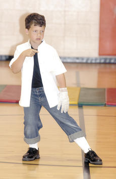 """<div class=""""source"""">Bryan Marshall</div><div class=""""image-desc"""">Second grader Jackson Reaves entertains the crowd during the school's talent show. Reaves did his best Michael Jackson impersonation.</div><div class=""""buy-pic""""><a href=""""/photo_select/5161"""">Buy this photo</a></div>"""