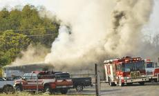 """<div class=""""source"""">Camille McClanahan</div><div class=""""image-desc"""">Fire shoots out of Mike's Auto Salvage on Oct. 21 in Cordova. The cause of the fire is unknown and an investigation is ongoing. The state fire marshal's office was going to visit the scene on Oct. 26. </div><div class=""""buy-pic""""></div>"""