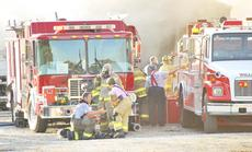 """<div class=""""source"""">Camille McClanahan</div><div class=""""image-desc"""">Firefighters from seven departments were on the scene of the fire at Mike's Auto Salvage off Ky. 36 in Cordova last week. Several small explosions ripped through the garage after the fire broke out.</div><div class=""""buy-pic""""></div>"""