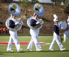 "<div class=""source""></div><div class=""image-desc"">Mitchell Elam blows into the tuba in formation. </div><div class=""buy-pic""></div>"