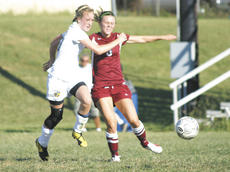 """<div class=""""source"""">Matt Birkholtz</div><div class=""""image-desc"""">Sophomore Mollie Pelfrey fights for the ball against Bourbon County Aug. 22. Pelfrey scored the only goal in the game, giving the Lady Braves their first win ever against Bourbon County, improving their 2011 record to 3-0.</div><div class=""""buy-pic""""><a href=""""/photo_select/11820"""">Buy this photo</a></div>"""