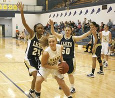 "<div class=""source"">Matt Birkholtz</div><div class=""image-desc"">Morgan McClure goes up for the shot against Lloyd Jan. 29.</div><div class=""buy-pic""><a href=""/photo_select/9187"">Buy this photo</a></div>"