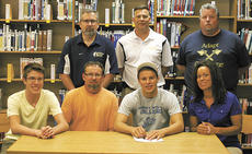 "<div class=""source"">Matt Birkholtz</div><div class=""image-desc"">Nick Cox signs his letter of intent with his parents Allen and Patricia Burkhart and brother, Michael, far left, with James Lacey, Scott Shipp and Mike Davis.</div><div class=""buy-pic""><a href=""/photo_select/10829"">Buy this photo</a></div>"