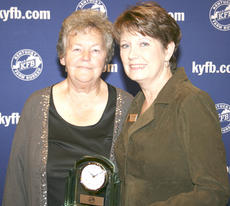 "<div class=""source""></div><div class=""image-desc"">Norma Kinsey, chair of the Grant County Farm Bureau Women's Committee, accepts the 2010 Gold Star Award of Excellence from Frieda Heath, chair of the Kentucky Farm Bureau State Women's Committee. The award was presented during a recognition program at the 91st Kentucky Farm Bureau annual meeting on Dec. 3.