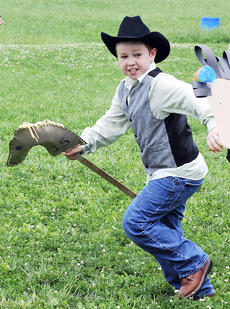 "<div class=""source"">Camille McClanahan</div><div class=""image-desc""> Jacob O'Neill races his stick horse.