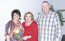 "<div class=""source"">Bryan Marshall</div><div class=""image-desc"">Sandi Neace, Kim and Tony McKinnon</div><div class=""buy-pic""><a href=""/photo_select/9301"">Buy this photo</a></div>"
