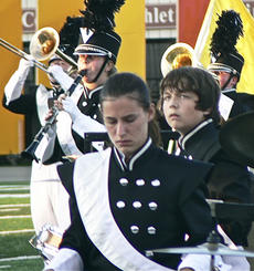 "<div class=""source""></div><div class=""image-desc"">Claire Kinmon, Alex Wyatt and WHS senior, Lauri Wyatt, play in formation with the marching band.</div><div class=""buy-pic""></div>"