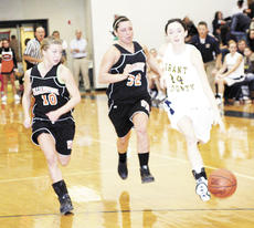 """<div class=""""source"""">Ryan Naus</div><div class=""""image-desc"""">Lady Brave Dawn Plunkett, right, races down the court as Lady Demons Haley Rothwell and Taylor Eldridge sprint to stop her.</div><div class=""""buy-pic""""><a href=""""/photo_select/4466"""">Buy this photo</a></div>"""