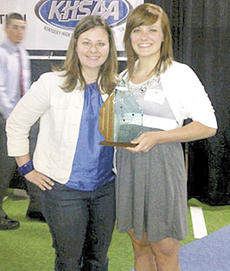 """<div class=""""source"""">Photo Submitted</div><div class=""""image-desc"""">Rebecca Saylor shows off her award with Lady Braves soccer coach Melinda White.</div><div class=""""buy-pic""""></div>"""