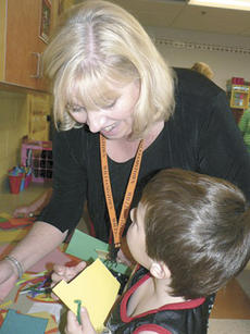 "<div class=""source"">Bryan Marshall</div><div class=""image-desc"">Williamstown Independent Schools Superintendent Sally Skinner works with a kindergarten student on a project during Grandparents' Day.</div><div class=""buy-pic""><a href=""/photo_select/14166"">Buy this photo</a></div>"