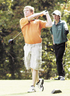 "<div class=""source"">Ryan Naus</div><div class=""image-desc"">Sean Moreland watches his drive during the Grant County Invitational on Sept. 19. During the region tournament, Moreland shot an 86.</div><div class=""buy-pic""><a href=""/photo_select/5775"">Buy this photo</a></div>"