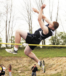 """<div class=""""source"""">Ryan Naus</div><div class=""""image-desc"""">Tyler Sheffield clears the bar during the high jump competition.</div><div class=""""buy-pic""""><a href=""""/photo_select/4230"""">Buy this photo</a></div>"""