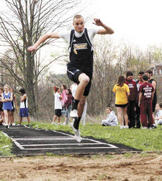"""<div class=""""source"""">Ryan Naus</div><div class=""""image-desc"""">Joe Soden times his jump to help him fly farther during the triple jump competition.</div><div class=""""buy-pic""""><a href=""""/photo_select/4229"""">Buy this photo</a></div>"""