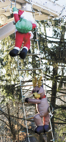 "<div class=""source""></div><div class=""image-desc"">Santa gets a boost from reindeer and elves at the home of Jeremy Souder on Main Street in Williamstown.</div><div class=""buy-pic""><a href=""http://web2.lcni5.com/cgi-bin/c2newbuyphoto.cgi?pub=195&orig=Souder1%2BWEB.jpg"" target=""_new"">Buy this photo</a></div>"