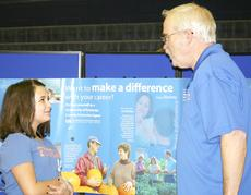 "<div class=""source""></div><div class=""image-desc"">University of Kentucky Extension Service assistant Lamar Fowler explains careers in extension services to Madison Stewart.</div><div class=""buy-pic""><a href=""/photo_select/9101"">Buy this photo</a></div>"