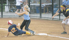 """<div class=""""source"""">Matt Birkholtz</div><div class=""""image-desc"""">Taryn Biddle slides safely into third, as coach Jeff Stith points for her to slide. </div><div class=""""buy-pic""""><a href=""""/photo_select/10909"""">Buy this photo</a></div>"""