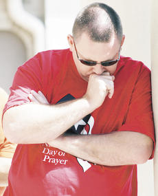 """<div class=""""source""""></div><div class=""""image-desc"""">Tony McKinnon, pastor of Family Worship Center in Williamstown, pauses a moment during ceremony at the Grant County Courthouse to offer a moment of prayer, as part of activities held during the National Day of Prayer.</div><div class=""""buy-pic""""><a href=""""/photo_select/6231"""">Buy this photo</a></div>"""