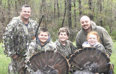 """<div class=""""source"""">Photo Submitted</div><div class=""""image-desc"""">Calvin Shebley, Anthony Shebley, Faith Shebley, Chuck Moore and Ashton Moore share their hunting experience.</div><div class=""""buy-pic""""></div>"""