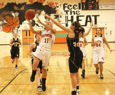 "<div class=""source"">Matt Birkholtz</div><div class=""image-desc"">Lady Demons senior Tori Wilhoit goes in for a layup against Bellevue on Senior Night Feb. 4.</div><div class=""buy-pic""><a href=""/photo_select/9167"">Buy this photo</a></div>"