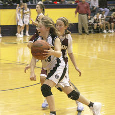 "<div class=""source"">Matt Birkholtz</div><div class=""image-desc"">Sixth grade Lady Brave Shania Young drives the lane against Ockerman.</div><div class=""buy-pic""><a href=""/photo_select/8828"">Buy this photo</a></div>"