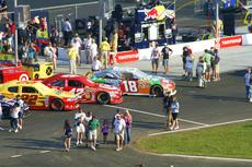 "<div class=""source"">Matt Birkholtz</div><div class=""image-desc"">Kyle Busch's 18 car sitting on pit road in the pole position.</div><div class=""buy-pic""><a href=""/photo_select/11332"">Buy this photo</a></div>"