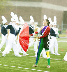 """<div class=""""source"""">annette crimmins PHOTOGRAPHY</div><div class=""""image-desc"""">The color guard doesn't miss a step as they dance in the rain. </div><div class=""""buy-pic""""><a href=""""/photo_select/19079"""">Buy this photo</a></div>"""