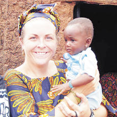"""<div class=""""source""""></div><div class=""""image-desc"""">Hutchinson holds a baby named after her.</div><div class=""""buy-pic""""><a href=""""/photo_select/5747"""">Buy this photo</a></div>"""
