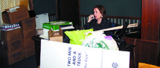 """<div class=""""source"""">Jamie Baker-Nantz</div><div class=""""image-desc"""">Barb Gutman talks on her cell phone as the last boxes are removed from the Grant County Extension Office's temporary location on U.S. 25 in Williamstown to their new home on Baton Rouge Road.</div><div class=""""buy-pic""""><a href=""""/photo_select/7678"""">Buy this photo</a></div>"""