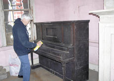 """<div class=""""source"""">Jamie Baker-Nantz</div><div class=""""image-desc"""">Betty Hausberger, one of about 20 volunteers interested in preserving Sherman Tavern, worked on cleaning upon a piano found inside the historic site</div><div class=""""buy-pic""""><a href=""""/photo_select/12194"""">Buy this photo</a></div>"""