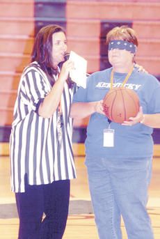 "<div class=""source"">Bryan Marshall, staff writer</div><div class=""image-desc"">Misty Middleton, district instructional supervisor, dressed as a referee as she hands a blindfolded Debbie Popham, fifth-grade teacher, a basketball during a skit.</div><div class=""buy-pic""><a href=""/photo_select/689"">Buy this photo</a></div>"