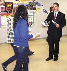 """<div class=""""source""""></div><div class=""""image-desc"""">Stephen Fightmaster as Mitt Romney greets his constituents at Grant County High School's mock presidential debate. Photo by Jamie Baker-Nantz</div><div class=""""buy-pic""""><a href=""""/photo_select/16125"""">Buy this photo</a></div>"""