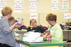 """<div class=""""source""""></div><div class=""""image-desc"""">Janet Howe and Sandy Thornton, volunteers, assist customers at the Helping Hands Thrift Store at the grand opening.</div><div class=""""buy-pic""""><a href=""""http://web2.lcni5.com/cgi-bin/c2newbuyphoto.cgi?pub=195&orig=cash%2Bregister.jpg"""" target=""""_new"""">Buy this photo</a></div>"""