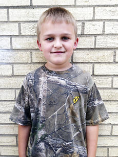 "<div class=""source""></div><div class=""image-desc""> Chaz Surrett is the WES primary student of the week. He is in Amy Hickman's second grade class. ""Chaz has a great sense of humor and is such fun to have in class. He works very hard, challenges himself, and is always willing to help others."" Hickman said.  His favorite thing about school is hanging out with friends.  His favorite book is Captain Underpants.  His favorite thing to do as a family is to play games and have bonfires.    Her favorite book is Junie B. Jones; Boo, I mean it.   Her favorite thing to do as a family is to go camping.  movies.   </div><div class=""buy-pic""><a href=""http://web2.lcni5.com/cgi-bin/c2newbuyphoto.cgi?pub=195&orig=chaz_surrett.jpg"" target=""_new"">Buy this photo</a></div>"