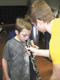 "<div class=""source""></div><div class=""image-desc"">Austin Johns blows on the clarinet while Lucas Hampton helps.  </div><div class=""buy-pic""><a href=""/photo_select/17888"">Buy this photo</a></div>"