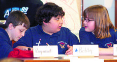 "<div class=""source""></div><div class=""image-desc"">Raymond Miller, Bobby Engelman and Madeline Morgan, members of Crittenden-Mount Zion Elementary's quick recall team, prepare to answer a question.</div><div class=""buy-pic""><a href=""/photo_select/6078"">Buy this photo</a></div>"