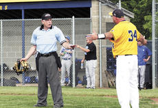 """<div class=""""source""""></div><div class=""""image-desc"""">Grant County High School Braves Coach Darrin Robinson protests a controversial call with an umpire in Sunday's district match up between the GCHS Braves and the Walton-Verona Bearcats. </div><div class=""""buy-pic""""><a href=""""/photo_select/17931"""">Buy this photo</a></div>"""